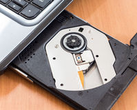 CD rom on laptop. Computer Stock Image