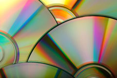 CD:s. Close up of compact discs with beautiful rainbow colors Royalty Free Stock Photography