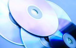 Cd's/dvd's. Few dvd's in blue tone Royalty Free Stock Photo