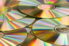 Cd's in golden reflections Stock Photos