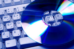 CD's & keyboard. Close up of CD's over  Computer keyboard Stock Image