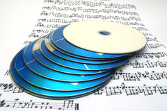 Cd's over a partiture Royalty Free Stock Images
