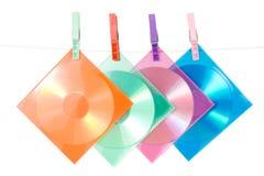 CD-schijven in multi-colored enveloppen Stock Afbeeldingen