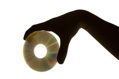 CD with silhouette. Dark hand with cd in the white background Royalty Free Stock Images