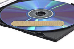 Cd-skivan med programvara lappar arkivbild