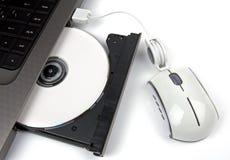 cd skjuter ut Arkivbild