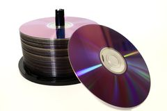 CD Stack. A stack of cd`s in a spindle and one on the side isolated on white background Stock Photo