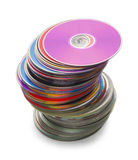 CD Stack. Computer Discs in a Large Leaning Stack Isolated on a White Background Royalty Free Stock Image