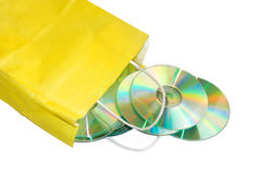 CD store. Yellow paper bag with CD isolated over white Stock Photos