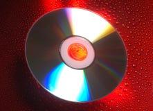 Cd su colore rosso Immagini Stock Libere da Diritti