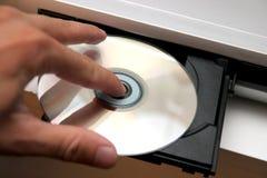 CD sur le lecteur de CD Images libres de droits