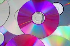 CD, teste padrão brilhante reflexivo da textura do fundo dos dvds do CD do dvd Fotografia de Stock