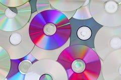 CD, teste padrão brilhante reflexivo da textura do fundo dos dvds do CD do dvd Fotos de Stock Royalty Free