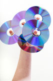 CD Tree. A person holding a bunch of Cds on each finger tip Stock Images