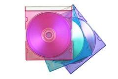 CD trois dans les caisses colorées Images stock