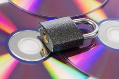Cd un disco e la serratura Fotografia Stock Libera da Diritti
