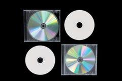 CD vier auf dem schwarzen Hintergrund lokalisiert Lizenzfreies Stockfoto