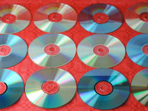 CD wallpaper. Twelve CD covering the background reflecting the sunbeams Stock Image