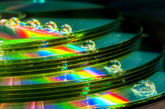 CD with water droplets. Stock pile of CD with water droplets Royalty Free Stock Photography