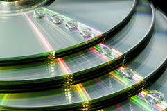 CD with water droplets. Stock pile of CD with water droplets Royalty Free Stock Images