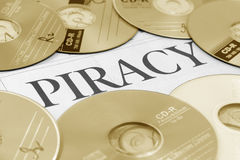 Cd and word of piracy Royalty Free Stock Photo