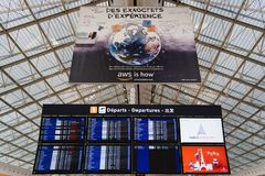 CDG Airport, Paris - 12/22/18: Departures information screen and aws amazon ad at Paris airport royalty free stock image