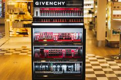 CDG Airport, Paris - 12/22/18: Givenchy shop logo, lipsticks and beauty products. CDG Airport, Paris - 12/22/18: Givenchy shop logo, Red white and high contrast royalty free stock images
