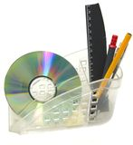 CDROM, pen, ruler. Close up of a CDROM, pen, ruler in plastic cup royalty free stock images