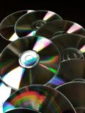 CDS, dvds. Close view of set of shinny cds  (and reflections Stock Photos