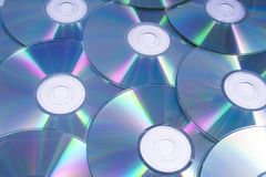 CDs or DVDs. A shot of shiny CDs or DVDs, over a white background royalty free stock photo