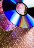 Cds on jigsaws Stock Photos