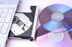 CDs with laptop disk drive Stock Images