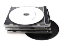 CDs and plastic boxes isolated. A stack of CDs and boxes isolated royalty free stock photo