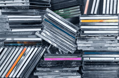 CDs in shelf. Piles of CDs in a shelf stock image
