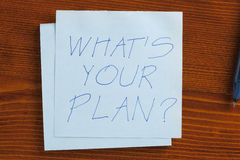 Ce qui est votre plan écrit sur une note Image libre de droits
