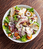 Ceasar salad with grilled chicken fillets, red onion rings, lettuce, orange cherry tomatoes, croutons, grated parmesan Stock Images