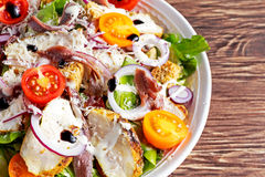 Ceasar salad with grilled chicken fillets, red onion rings, lettuce, orange cherry tomatoes, croutons, grated parmesan Stock Photography