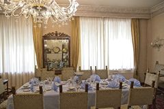 Ceausescu Palace Dinning Room. BUCHAREST, ROMANIA - MARCH 7, 2017: The Ceausescu Palace or sometimes called The Ceausescu Mansion or Spring Palace.  Was restored stock photos