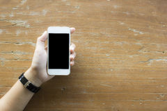 Ceautiful woman hand holding white smartphone Stock Photos