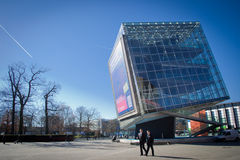 CeBIT area. A big leaning glass building on the CeBIT fair grounds in Hanover 2013. Business people Royalty Free Stock Image