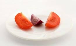 Cebola e tomates foto de stock