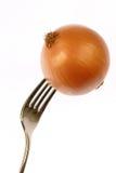 Cebolla en fork fotos de archivo