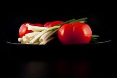 Cebollas y tomates Imagen de archivo libre de regalías