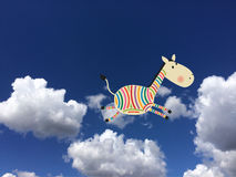 Cebra coloreada en las nubes Imagenes de archivo