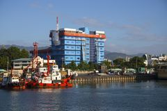 Cebu City, the Philippines - March 22, 2018: sea port view with court building. Tourist city port. Sea port landscape with modern ships. Cargo and royalty free stock photos
