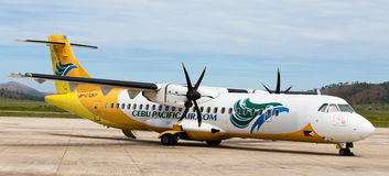 Cebu Pacific airplane in Busuanga airport Stock Photos