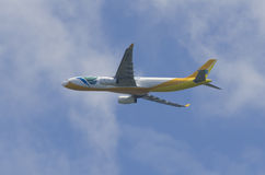 Cebu Pacific. Plane in flight, with undercarriage and engines visible Stock Images