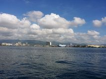 Cebu. Taken from a ferry, the background is either Mandaue City or Cebu City in the Philippines stock photo