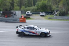 Ceccato Motor Racing Team BMW M4 in action. Photo taken at the Monza circuit in occasion of the first 2019 Endurance Series race of the Italian GT Championship royalty free stock images
