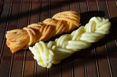 Two braids of Cecil cheese: ordinary and smoked royalty free stock photography
